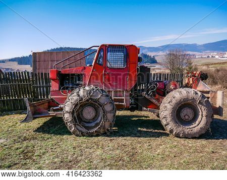 Fitod, Romania- 11 April 2021: Side View Of An Old Romanian Forestry Taf Machinery  With Chains On T