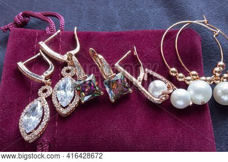 Indian Traditional Wedding Jewellery, Bangles With Earrings In Red Background.