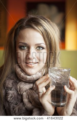 Young Woman With Beautiful Blue Eyes Drinking Water