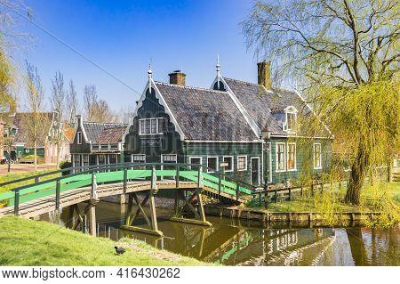 Zaanse Schans, Netherlands - March 31, 2021: Traditional Dutch Wooden House A The Canal In Zaanse Sc