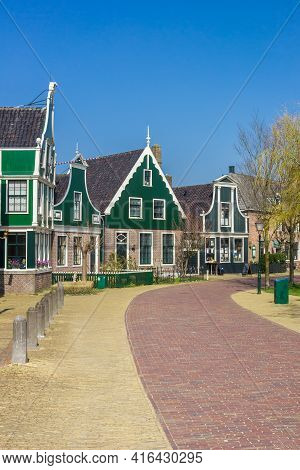 Zaanse Schans, Netherlands - March 31, 2021: Traditional Dutch Houses In The Central Street Of Zaans