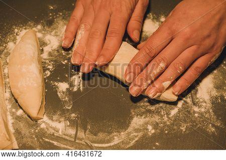 Women's Hands Kneading Dough For Baking. Women's Hands Kneading Dough For Baking.