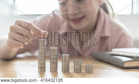 Woman's hands put the coins arranged in steps, Managing your finances or saving money for future use