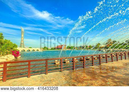 Doha, Qatar - February 21, 2019: Aspire Tower Hotel And Bridge With Fountain In Aspire Park, Dohas B