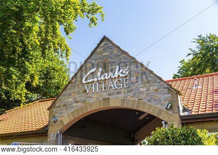Editorial, Entrance Sign For Clarks Village Outlet Shopping Village