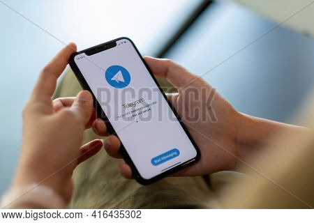 Chiang Mai, Thailand - Apr 11, 2021: Woman Hand Holding Iphone X With Social Networking Service Tele