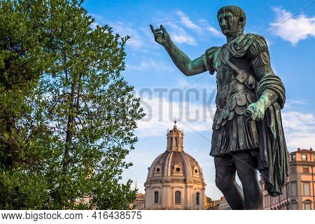 Italy, Rome - Circa August 2020: Statue Of Caesar Emperor, Made Of Bronze. Natural Sunrise Light. An