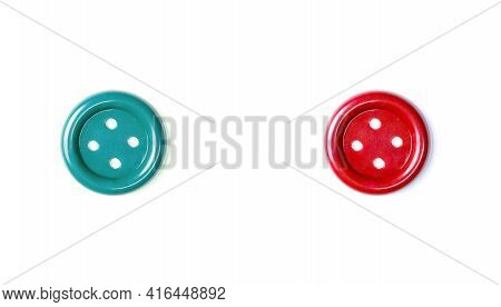 Red And Green Buttons On A White Background Close-up. Two Beautiful Isolate Buttons For Cutting Out.