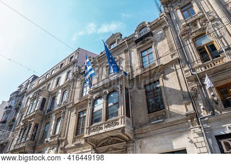 Taksim, Istanbul, Turkey - 03.12.2021: Low Angle View Of Greek And European Union Flags On Historica