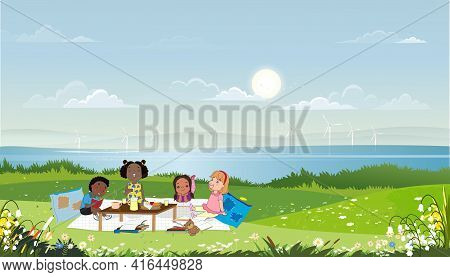 Group Of Kids Having Picnic By The Lake In Sunny Day Spring Or Summer,children Sitting On Blanket Re