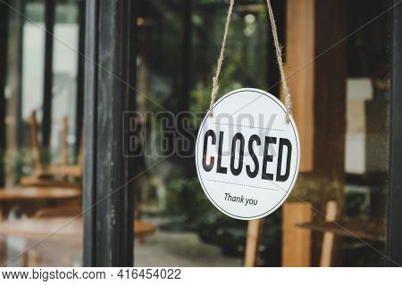 Closed. Coffee Cafe Text On Vintage Sign Board Hanging On Glass Door In Modern Cafe Coffee Shop, Reo