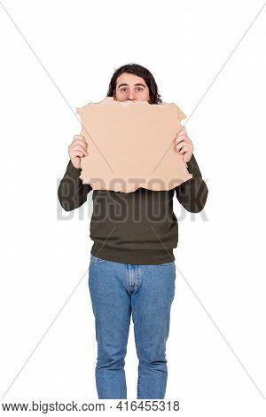 Stressed Man, Refugee Or Beggar, Holding A Blank Cardboard Sheet, Copy Space For Messages. Empty Ban