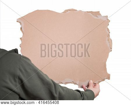 Activist Hand Holding A Blank Cardboard Sheet, Participating In A Street Demonstration Or Protest. B
