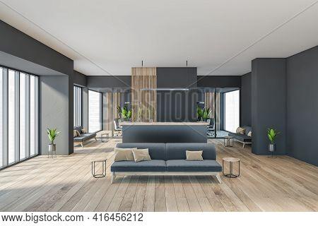 Dark Modern Minimalist Office Room Interior With Cozy Grey Couch, Wooden Parquet Floor, Panoramic Wi