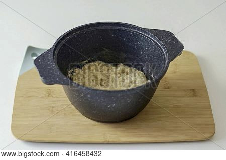 Reduce The Temperature And Cook The Porridge Under The Lid As Required According To The Instructions