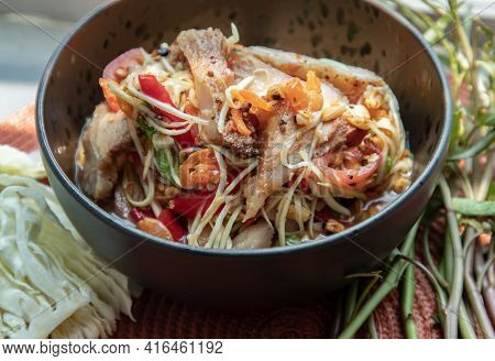 Close-up Of Thai Papaya Spicy Salad (som Tum) Mix Grilled Pork Neck On Ceramic Dishes. Delicious Spi