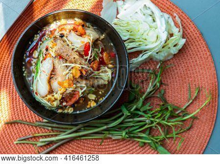 Thai Papaya Spicy Salad (som Tum) Mix Grilled Pork Neck On Ceramic Dishes. Delicious Spicy Thai Food