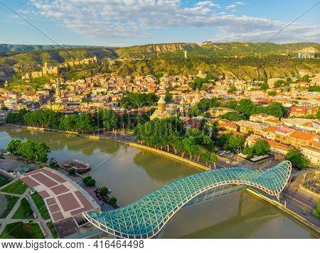 Tbilisi, Georgia  - June 22, 2018: Beautiful View Of Kura River And Bridge Of Peace In Tbilisi, Geor