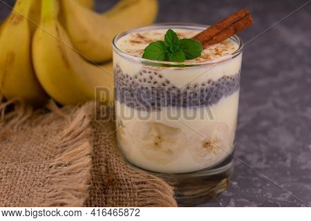 Banana Yogurt With Cinnamon In A Glass On A Gray Background. Close-up.