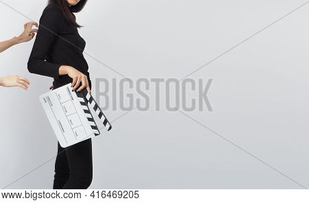 Asian Woman Is Holding White Clapper Board Or Movie Slate Or Clapboard Use In Video Production ,film