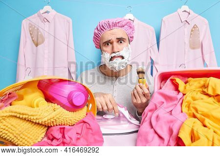 Puzzled Multitasking Husband Busy Doing Laundry Ironing And Shaving At Home Has Much Work About Hous