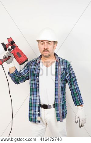 The Builder Repairman Holds In His Hand An Electric Paintbrush For Painting The Walls On A White Bac