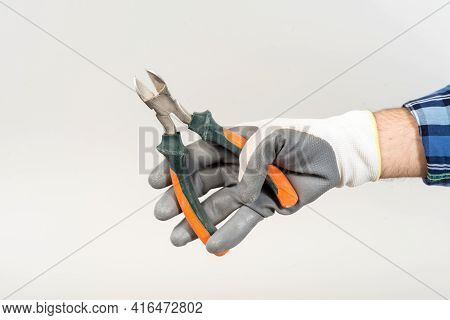 Worker Repairing Holding Construction Nippers In Hand On White Background