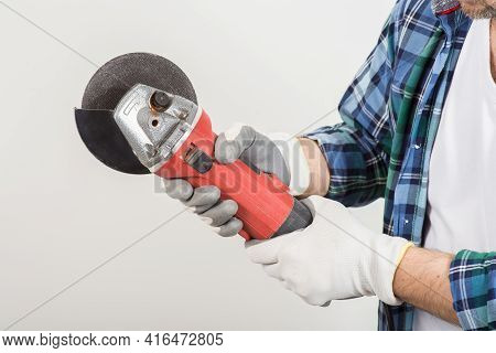 Worker Repairing Holding Construction Grinder In Hand On White Background