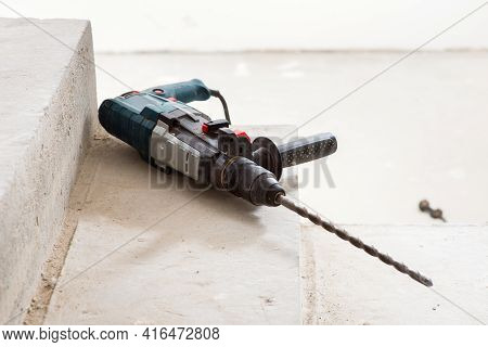 Construction Hammer Drill On A Concrete Staircase, During The Construction Of A House