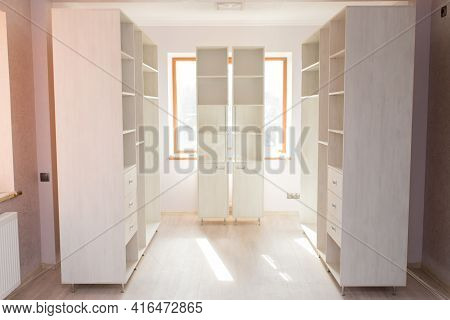 A Set Of Wardrobes For Light Color Cabinet Furniture In An Empty Room