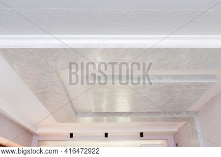 Volumetric Plasterboard Construction On The Ceiling, With Ceiling Moldings And Decorative Plaster