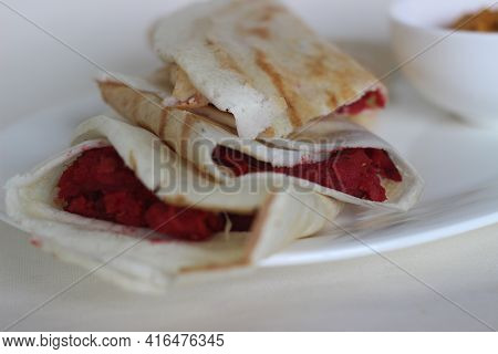 Dosa Rolls With Beetroot Masala Inside. Locally Known As Beetroot Masala Dosa.