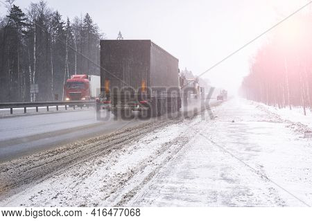Trucks On The Highway In Dirty Weather, Dangerous Driving Conditions In Winter In Cloudy Weather.