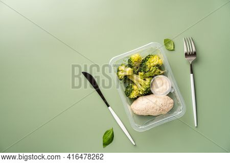 Healthy Balanced Lunch Box. Chicken Burgers With Broccoli On Light Green Background, Top View. Offic