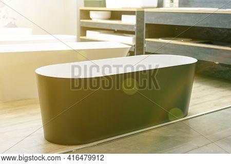 Black Bathtub At A Hardware Store. Sanitary Engineering Shop. Toned