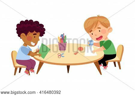 Little Boys Sitting At Table Paper Crafting In Kindergarden Vector Illustration