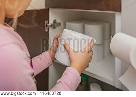 Toilet Paper, Roll Of Toilet Paper In Hand. Stocks Of Toilet Paper. Girl Puts Toilet Paper In The Ca