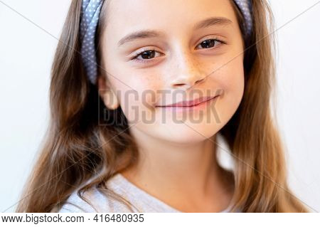 Happy Kid Portrait. Child Beauty. Positive Emotion. Satisfied Relaxed Cute Smiling Little Girl Face