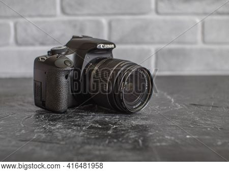 Russia, Krasnodar - April 2, 2021: Old Worn Canon 500d Slr Camera With 18-55mm Whale Lens
