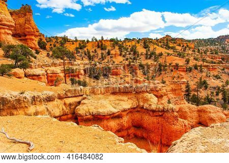 USA. Red-brown canyons and outliers are composed of soft sedimentary rocks. The most popular trails in Red Canyon. Red Canyon Arches trail in Losee Canyon.
