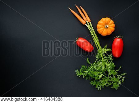Bio Bouquet Of Fresh Carrots With Green Leaves