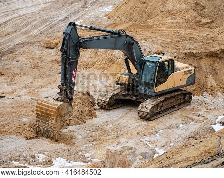 Track Type Loader Excavator In Large White Sand Quarry. Excavator Loader Machine During Earthmoving