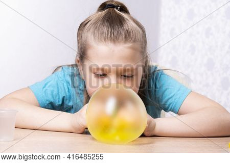 The Blonde Child Inflates A Bubble Of Yellow Mucus. Play A Slime Toy. Making Slime At Home.