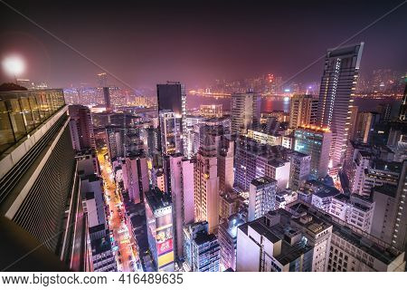 Hong Kong - 05 April 2019 - Aerial Rooftop View Of Futuristic Urban City Setting With Skyscrapers An