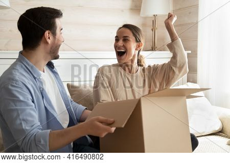 Excited Couple Triumph Unboxing Package Shopping Online