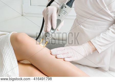 The Procedure For Removing Hair On The Body Of A Woman In A Cosmetology Clinic. Laser Hair Removal.