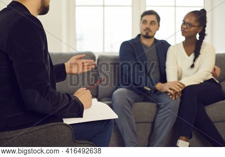 Unfocused Couple Listening Family Consultant Giving Advice To Solve Problem