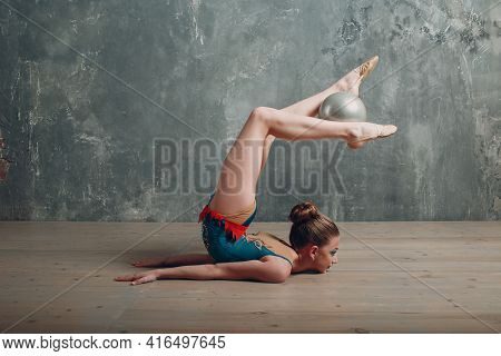 Young Girl Professional Gymnast Woman Dance Rhythmic Gymnastics With Ball At Studio