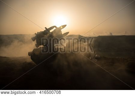 War Concept. Battle Scene With Rocket Launcher Aimed At Gloomy Sky At Sunset Time. Rocket Vehicle Re