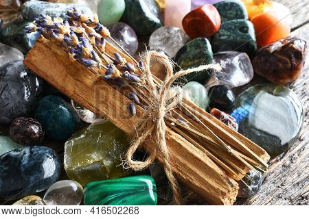 A Close Up Image Of Several Pieces Of Holy Wood Smudge Sticks With Dried Lavender And Healing Crysta